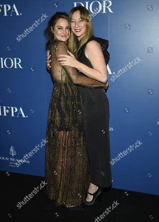 Stock Photo of Shailene Woodley, Isidora Goreshter. Shailene Woodley, left, and Isidora Goreshter attend The Hollywood Foreign Press Association and The Hollywood Reporter's Toronto International Film Festival party on day three of TIFF at the Four Seasons Hotel, in Toronto