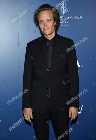 August Diehl attends The Hollywood Foreign Press Association and The Hollywood Reporter's Toronto International Film Festival party on day three of TIFF at the Four Seasons Hotel, in Toronto