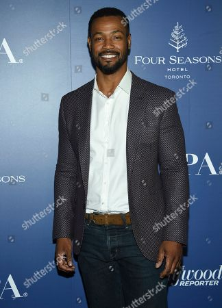 Isaiah Mustafa attends The Hollywood Foreign Press Association and The Hollywood Reporter's Toronto International Film Festival party on day three of TIFF at the Four Seasons Hotel, in Toronto