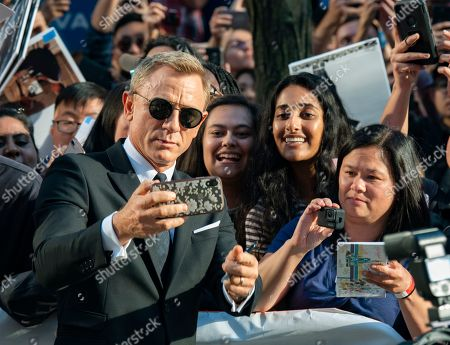 English actor and cast member Daniel Craig (L) poses for photographs with fans at the screening of the movie 'Knives Out' during the 44th annual Toronto International Film Festival (TIFF) in Toronto, Canada, 07 September 2019. The festival runs 05 to 15 September.