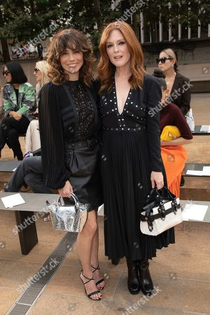 Linda Cardellini, Julianne Moore. Actresses Linda Cardellini, left, and Julianne Moore attend the Longchamp runway show at Lincoln Center during NYFW Spring/Summer 2020, in New York