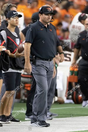 Oregon State head coach Jonathan Smith looks on as his team plays Hawaii during the first half of an NCAA college football game, in Honolulu
