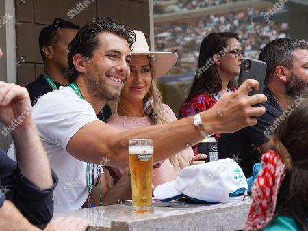 Stock Photo of Jason Tartick and Kaitlyn Bristowe stop by the Heineken suite