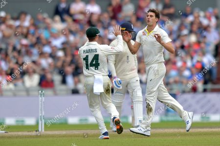 Australia's Pat Cummins celebrates bowling out England's Jason Roy during day five of the fourth Specsavers Ashes test series at Old Trafford, Manchester, UK