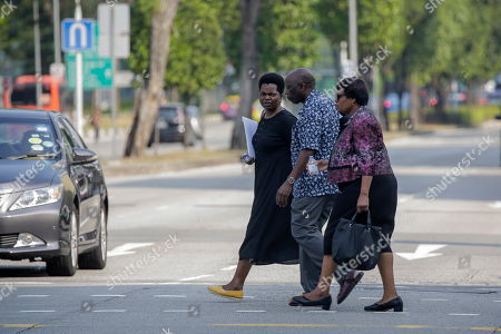 Visitors leave after a religious service at the Singapore Casket funeral parlour, where the body of former Zimbabwe President Robert Mugabe is being held in Singapore, 08 September 2019. Mugabe, who had been receiving treatment in Singapore since April this year, died on 06 September aged 95. Mugabe became prime minister of Zimbabwe (formerly known as Rhodesia) in 1980 after the country's independence from Britain and served as president from 1987 until his resignation in 2017.