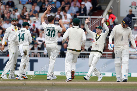 Australia's Pat Cummins, no. 30, celebrates with teammates after dismissing England's Jason Roy during day five of the fourth Ashes Test cricket match between England and Australia at Old Trafford in Manchester, England