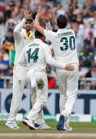 Australia's Pat Cummins, right, celebrates with teammates after dismissing England's Jason Roy during day five of the fourth Ashes Test cricket match between England and Australia at Old Trafford in Manchester, England