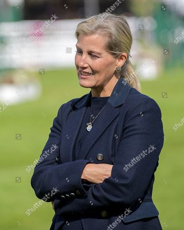 Stock Photo of HRH the Countess of Wessex watches the proceedings from out of camera shot of Sir Mark Todd and Clare Balding on his official retirement from competitive riding. The Land Rover Burghley on Sunday 8th September.