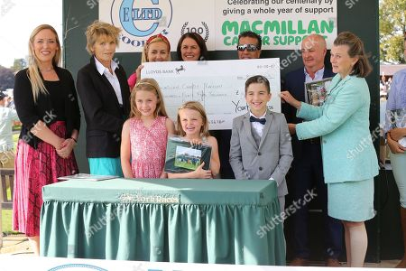 Stock Image of The 2019 Macmillan Riders were presented with their momento after taking part in the race earlier this year and raising £645,000 for the Macmillan Charity during the Family Race Day held at York Racecourse, York