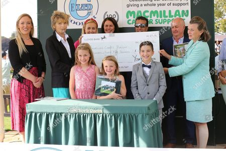 The 2019 Macmillan Riders were presented with their momento after taking part in the race earlier this year and raising £645,000 for the Macmillan Charity  during the Family Race Day held at York Racecourse, York