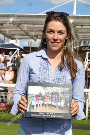 Charlotte Atkinson the 2019 Macmillan Race Winner with her momento  during the Family Race Day held at York Racecourse, York