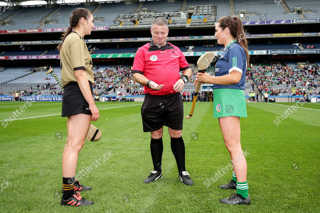 Stock Image of Kerry vs Limerick. Kerry's Niamh Leen, referee Gavin Donegan and Limerick's Grace Lee during the coin toss