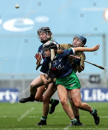 Kerry vs Limerick. Kerry's Olivia Dineen with Yvonne Lee and Kate Herbert of Limerick