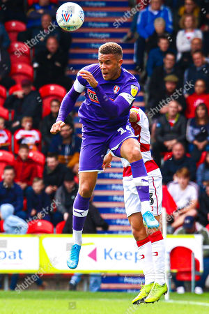 Carlton Morris of Rotherham United beats Reece James of Doncaster Rovers to head the ball