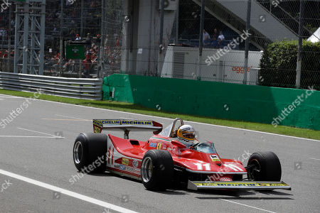 Stock Photo of Former Formula One World Champion Jody Scheckter drives his 1979 Ferrari car to celebrate the 40th anniversary of his 1979 Formula 1 World Championship victory before the Formula One Italy Grand Prix at the Monza racetrack, in Monza, Italy