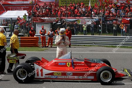 Former Formula One World Champion Jody Scheckter stands behind his 1979 Ferrari car to celebrate the 40th anniversary of his 1979 Formula 1 World Championship victory before the Formula One Italy Grand Prix at the Monza racetrack, in Monza, Italy