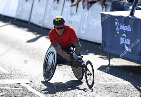 David Weir crosses the finish line to win the Wheelchair race in the Great North Run 2019