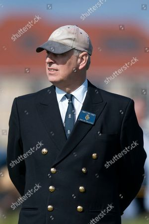 Britain's Prince Andrew watches play on the second tee at the Walker Cup golf trophy between the United States and the Great Britain and Ireland team at Royal Liverpool Golf Club in Hoylake, England