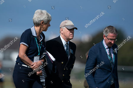 Britain's Prince Andrew walks on the course with Tudor Williams, right, captain of the Royal Liverpool Golf Club and Dr Maureen Richmond, Captain of the Ladies, at the Royal Liverpool Golf Club in Hoylake, England