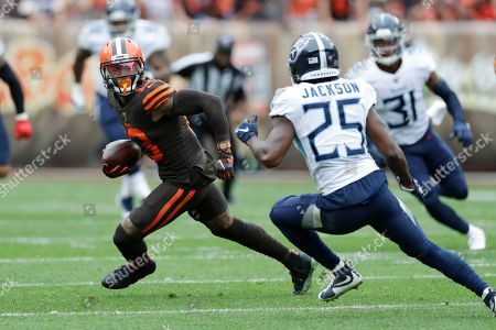 Stock Picture of Cleveland Browns wide receiver Odell Beckham Jr. (13) runs with the ball after a pass reception against Tennessee Titans cornerback Adoree' Jackson (25) during the first half in an NFL football game, in Cleveland