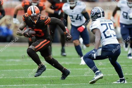 Cleveland Browns wide receiver Odell Beckham Jr. (13) runs with the ball after a pass reception against Tennessee Titans cornerback Adoree' Jackson (25) during the first half in an NFL football game, in Cleveland