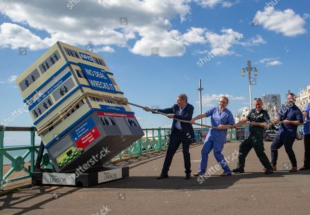 On the opening day of the 151st TUC Conference, Health workers and Unison General Secretary, Dave Prentis, hold a rope to try to stop a two metre-high hospital 'crashing' over the railings. The message on the front of the On-the-brink Hospital reads 'No Deal Wrecks It'. The stunt aims to highlight the vital role that Health workers play supporting the NHS and the risk an irresponsible no-deal Brexit poses.