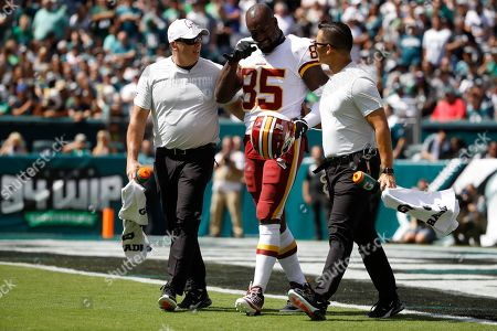 Washington Redskins' Vernon Davis walks off the field after an injury during the first half of an NFL football game against the Philadelphia Eagles, in Philadelphia