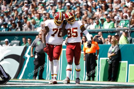 Washington Redskins' Vernon Davis, right, and Morgan Moses celebrate after Davis' touchdown during the first half of an NFL football game against the Philadelphia Eagles, in Philadelphia