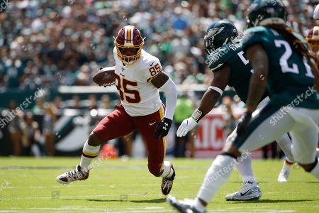 Washington Redskins' Vernon Davis runs after a catch during the first half of an NFL football game against the Philadelphia Eagles, in Philadelphia
