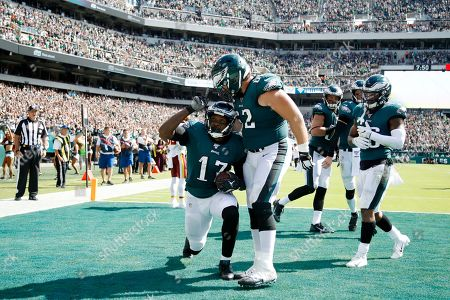 Philadelphia Eagles' Alshon Jeffery, left, celebrates with Jason Kelce after scoring a touchdown during the second half of an NFL football game against the Washington Redskins, in Philadelphia