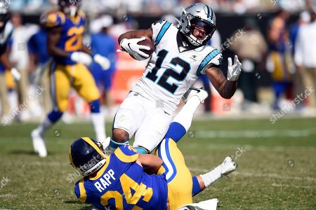 Los Angeles Rams safety Taylor Rapp (24) tackles Carolina Panthers wide receiver D.J. Moore (12) during the second half of an NFL football game in Charlotte, N.C