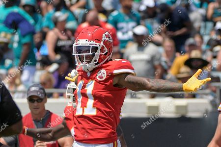 Kansas City Chiefs wide receiver Demarcus Robinson (11) celebrates after teammate wide receiver Sammy Watkins scored a touchdown against the Jacksonville Jaguars during the first half of an NFL football game, in Jacksonville, Fla