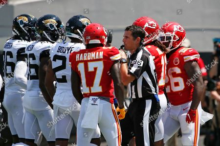 Stock Photo of Umpire Undrey Wash (96) breaks up an altercation between the Jacksonville Jaguars, left, and the Kansas City Chiefs during the first half of an NFL football game, in Jacksonville, Fla