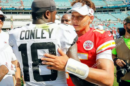 Kansas City Chiefs quarterback Patrick Mahomes, right, shakes hands with Jacksonville Jaguars wide receiver Chris Conley (18) after an NFL football game, in Jacksonville, Fla