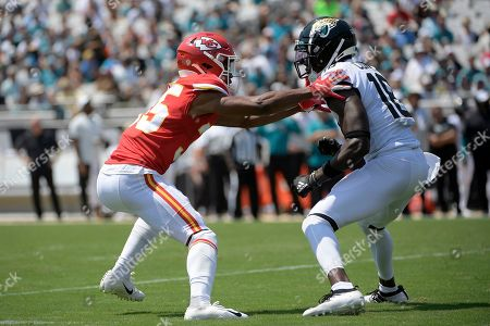 Kansas City Chiefs cornerback Charvarius Ward (35) works against Jacksonville Jaguars wide receiver Chris Conley (18) during the first half of an NFL football game, in Jacksonville, Fla