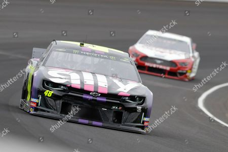Jimmie Johnson drives through the first turn during the NASCAR Brickyard 400 auto race at Indianapolis Motor Speedway, in Indianapolis