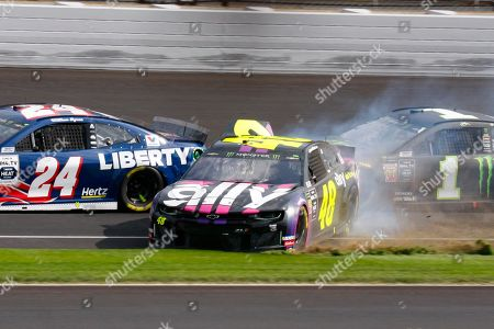 Jimmie Johnson, Kurt Busch. NASCAR driver Jimmie Johnson (48) makes contact with Kurt Busch (1) in the second turn during the NASCAR Brickyard 400 auto race at the Indianapolis Motor Speedway, in Indianapolis
