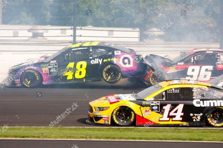 Stock Photo of Jimmie Johnson, Parker Kligerman. NASCAR driver Jimmie Johnson (48) is hit by Parker Kligerman (96) in the second turn during the NASCAR Brickyard 400 auto race at the Indianapolis Motor Speedway, in Indianapolis
