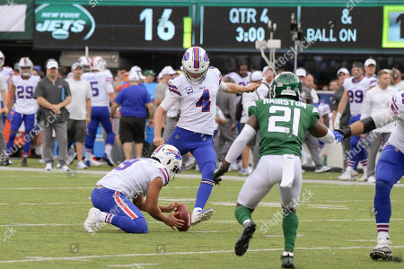 Buffalo Bills kicker Stephen Hauschka (4) kicks the point after try during the second half of an NFL football game, in East Rutherford, N.J