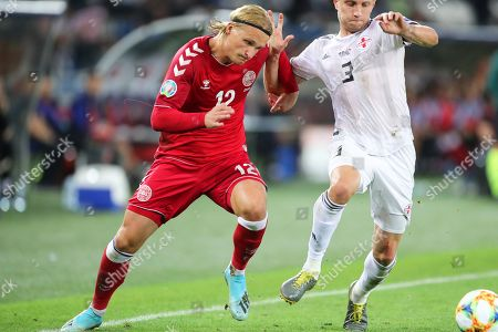 Denmark's Kasper Dolberg (L) in action against Georgia's Jemal Tabidze (R) during the UEFA EURO 2020 group D qualifying soccer match between Georgia and Denmark at the Boris Paichadze national stadium in Tbilisi, Georgia, 08 September 2019.