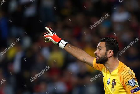 Portugal goalkeeper Rui Patricio reacts during the Euro 2020 group B qualifying soccer match between Serbia and Portugal, on the stadium Rajko Mitic in Belgrade, Serbia