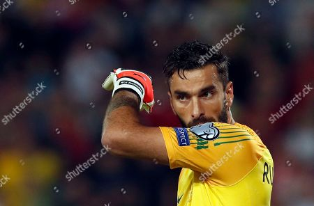 Portugal goalkeeper Rui Patricio wipes his face during the Euro 2020 group B qualifying soccer match between Serbia and Portugal, on the stadium Rajko Mitic in Belgrade, Serbia