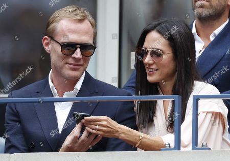 US actress Jennifer Connelly (R) and husband and British actor Paul Bettany (L) in the stands as Rafael Nadal of Spain plays Daniil Medvedev of Russia during the men's final match on the fourteenth day of the US Open Tennis Championships the USTA National Tennis Center in Flushing Meadows, New York, USA, 08 September 2019. The US Open runs from 26 August through 08 September.