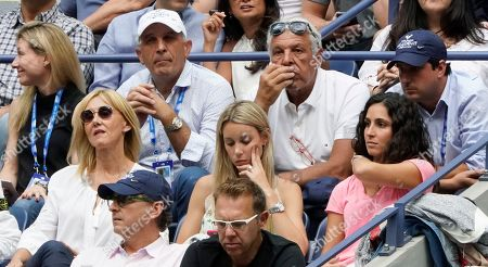 Ana Maria Parera, left, Maria Isabel Nadal, center, Xisca Perello, right, and Sebastian Nadal, top center, watch play between Rafael Nadal, of Spain, and Daniil Medvedev, of Russia, during the men's singles final of the U.S. Open tennis championships, in New York