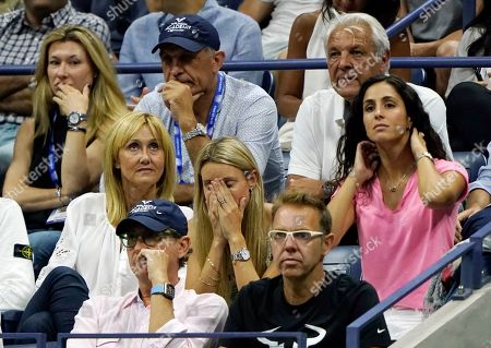 Ana Maria Parera, left, Maria Isabel Nadal, center, Xisca Perello, right, Sebastian Nadal, upper right, watch play between Rafael Nadal, of Spain, and Daniil Medvedev, of Russia, during the men's singles final of the U.S. Open tennis championships, in New York