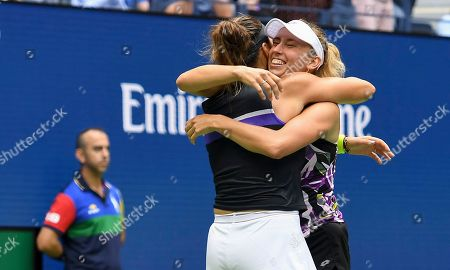 Elise Mertens, of Belgium, right, celebrates with doubles partner Arena Sabalenka, of Belarus, after winning the women's doubles final against Victoria Azarenka, of Belarus, and Ashleigh Barty, of Australia, at the U.S. Open tennis championships, in New York