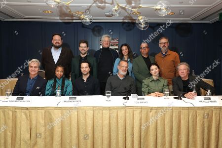 Stock Picture of Toronto, Canada - Sept. 8, 2019: Tom Junod, Noah Harpster, Writer/Executive Producer, Susan Kelechi Watson, Micah Fitzerman-Blue, Writer/Executive Producer, Matthew Rhys, Marc Turtletaub, Producer, Leah Holzer, Producer, Tom Hanks, Youree Henley, Producer, Marielle Heller, Director, Peter Saraf, Producer, and Chris Cooper seen at TriStar Pictures 'A Beautiful Day in the Neighborhood' panel discussion at The Fairmont Royal York during the Toronto International Film Festival.