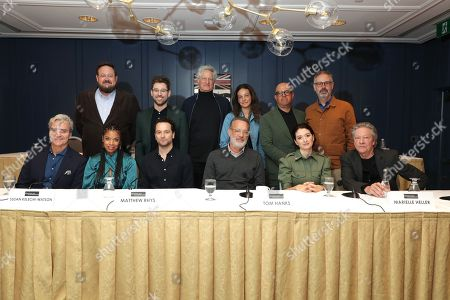 Stock Image of Toronto, Canada - Sept. 8, 2019: Tom Junod, Noah Harpster, Writer/Executive Producer, Susan Kelechi Watson, Micah Fitzerman-Blue, Writer/Executive Producer, Matthew Rhys, Marc Turtletaub, Producer, Leah Holzer, Producer, Tom Hanks, Youree Henley, Producer, Marielle Heller, Director, Peter Saraf, Producer, and Chris Cooper seen at TriStar Pictures 'A Beautiful Day in the Neighborhood' panel discussion at The Fairmont Royal York during the Toronto International Film Festival.