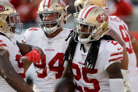 San Francisco 49ers cornerback Richard Sherman (25) celebrates with his teammates after his touchdown against the Tampa Bay Buccaneers during the second half an NFL football game, in Tampa, Fla