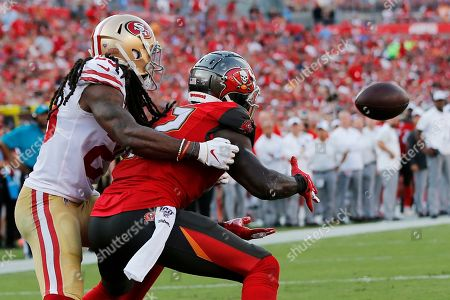 Tampa Bay Buccaneers wide receiver Chris Godwin (12) prepares to make a touchdownn catch in the end zone against San Francisco 49ers cornerback Richard Sherman (25) during the second half an NFL football game, in Tampa, Fla